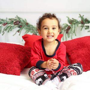 Girl in christmas pyjamas in photoshoot